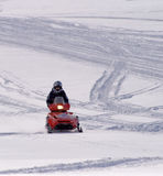 Snowmobiling in the Big Horn Mountains of Wyoming. Teenage boy snowmobling in the Big Horn Mountains of Wyoming Stock Photography