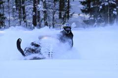 Snowmobiling chaufförexpertis arkivbild