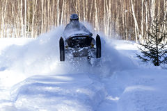 Snowmobiling in deep powder with high speed Royalty Free Stock Image