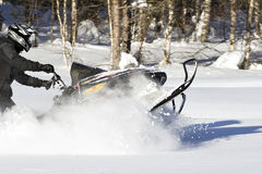 Snowmobiling in deep powder Royalty Free Stock Photography