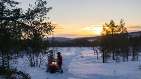 Snowmobiling in the Finnish Lapland stock image