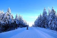 Free Snowmobiling On Snowy Mountain Road With Snow Covered Pine Trees Royalty Free Stock Photos - 120584278