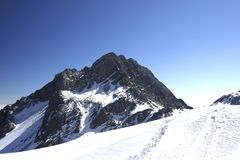 Snowmountain snow mountain under blue sky stock photos
