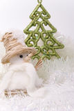 Snownan an fir. New-year toys snowman and new-year tree Royalty Free Stock Photography