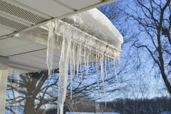 Snowpack and icicles in winter. Stock Images
