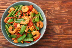 Snowpeas and shrimps salad Stock Photo