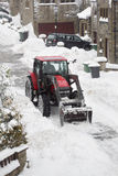 Snowplough clearing a residential road Stock Photo