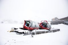 Snowploughs machinery plowing snow on ground in Tyrol, Austria Royalty Free Stock Photography