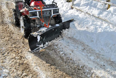 Snowplow. To work on the road Stock Photography