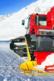 Snowplow. Red snowplow on a slope Stock Images
