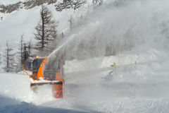 Snowplow. Removing snow from intercity road from snow blizzard Royalty Free Stock Images