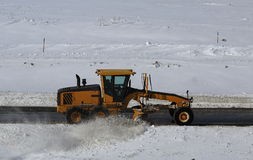 Snowplow. Cleans snow on the road Royalty Free Stock Photography