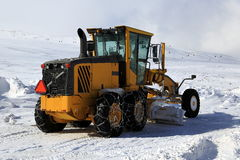 Snowplow. Cleans snow on the road Stock Photos