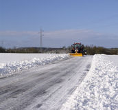 Snowplow. In action on rural snow covered road stock image
