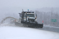 Snowplow in action. Taken on a grey snowy day on highway 69 south Royalty Free Stock Images