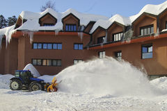 A snowplow in action. In the parking lot of an hotel Royalty Free Stock Images