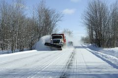 Snowplow in action. After a snowstorm Stock Photography