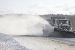 Snowplow in action. Taken on highway 69 south after a winter storm Royalty Free Stock Photo
