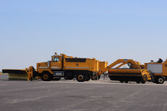 Snowplow at  airport. A snowplow attached to a truck at an airport Royalty Free Stock Photography