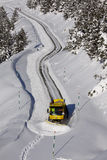 Snowplow cleaning the road. In the spanish Pyrenees after the storm. this is a topic view of the winter in Aran Valley, in Catalonia Royalty Free Stock Photos