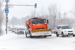 Snowplow is cleaning a road. Snowplow is cleaning a street in the city Royalty Free Stock Image