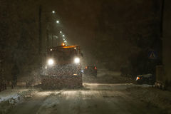 Snowplow cleaning streets. A snowplow cleaning streets in the aggravated traffic due to strong snowfall Stock Images