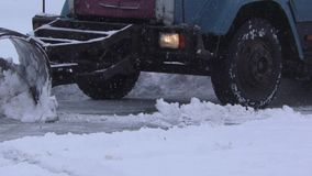 Snowplow cleans road stock footage