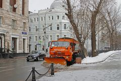 Snowplow cleans from the road snow in Moscow Royalty Free Stock Images