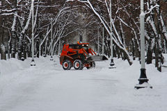 Snowplow cleans from the road snow on Tverskoy boulevard in Moscow Stock Image