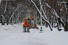 Snowplow cleans from the road snow on Tverskoy boulevard in Moscow Royalty Free Stock Photography