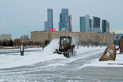 Snowplow cleans from the road snow in Victory park in Moscow Stock Photography
