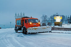 Snowplow cleans from the road snow Royalty Free Stock Photo