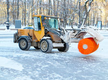 Snowplow cleans a sidewalk. In a European city Royalty Free Stock Photos