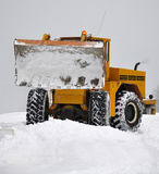 Snowplow clearing road Stock Image