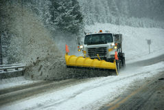 Snowplow clearing road. In snowstorm,Rocky Mountains,Idaho Stock Photography