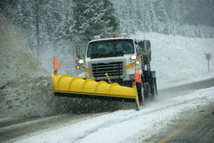 Snowplow clearing road Royalty Free Stock Photography