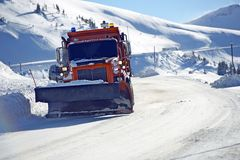Snowplow Clearing Road Stock Photos