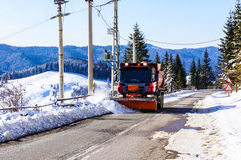 Snowplow clearing road. Scenic view of snowplow clearing road in countryside Royalty Free Stock Photography