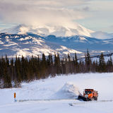Snowplow clearing road in scenic Yukon T Canada stock photography