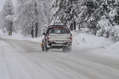 Snowplow clearing road Royalty Free Stock Image