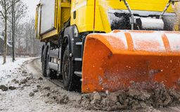 Snowplow clearing road, winter service royalty free stock images