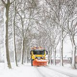 Snowplow clearing road, winter service stock photo