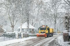 Snowplow clearing road, winter service royalty free stock photos