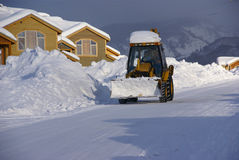 Snowplow clearing streets royalty free stock photography