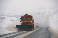 Snowplow clearing streets Royalty Free Stock Image