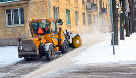 The snowplow clears away the street. Stock Images