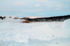 Snowplow do aeroporto no por do sol Fotos de Stock Royalty Free