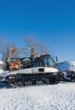 Snowplow en las montan@as Foto de archivo libre de regalías