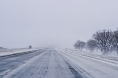 Snowplow on Highway. A snowplow on a highway in Kansas during a snowstorm Royalty Free Stock Photos