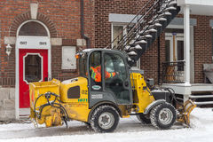 Snowplow in motion during snow storm Stock Photo